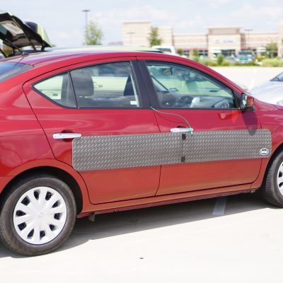 Car door protection panel size large on red car, by DentGoalie